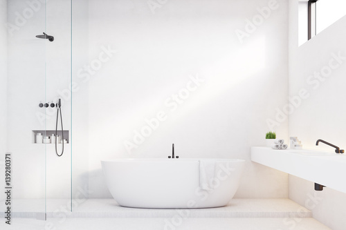 Valokuva  Luxury bathroom with white walls and shower