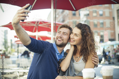 Couple Posing For A Selfie At Outdoor Cafe