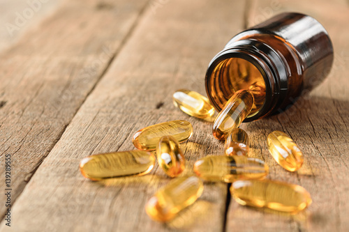 closeup supplements vitamins bottle on wood background