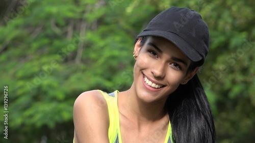 Valokuva  Smiling Happy Teen Girl Wearing Baseball Cap