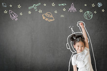 Creative Innovation Educational Conceptual Idea With Happy Little Asian Girl Kid In Astronaut Suit Doodle Drawing, Universe Space Out Of Earth Planet On School Class Chalkboard Chalk Board Background