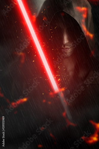 Photo Dark young man holding a lightsaber