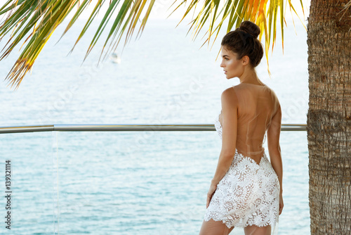 Fotografering  Gorgeous woman in beautiful white dress
