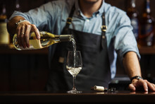 Male Sommelier Pouring White W...