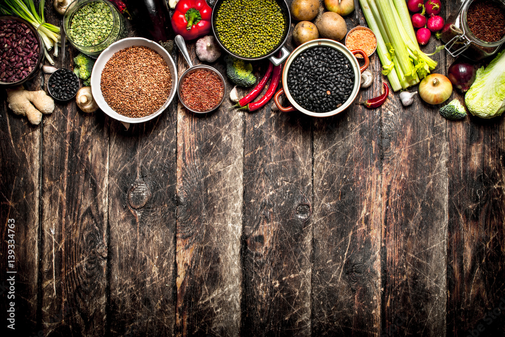 Fototapety, obrazy: Organic Food. A variety of beans with fresh vegetables and spices. On the old wooden table.