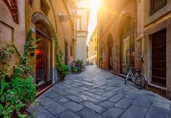 Fototapeta Narrow old cozy street in Lucca, Italy