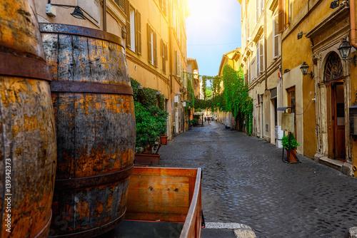 Poster Rome Cozy old street in Trastevere in Rome, Italy
