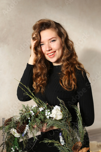 Valokuvatapetti Young attractive girl smiling with dimples and curls of blond ha