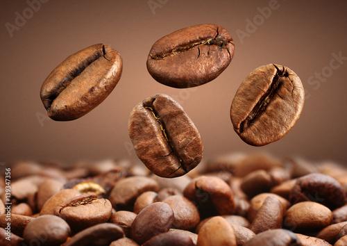 Poster de jardin Salle de cafe Closeup falling coffee bean on brown background