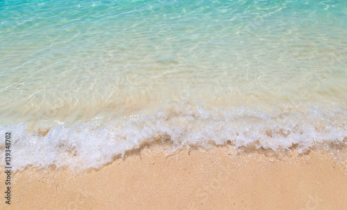Foto auf Gartenposter Strand Soft wave of the sea on the sandy beach at Thailand.