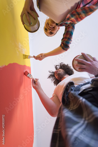 Fotografering  couple painting interior wall
