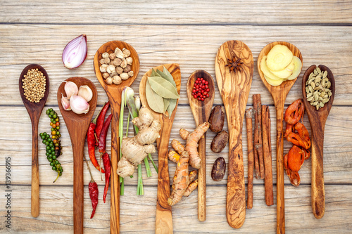 Fotografie, Obraz  Various of spices and herbs in wooden spoons