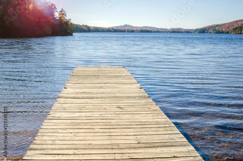 Wooden Jetty on a Beautiful Mountain Lake in Autumn.