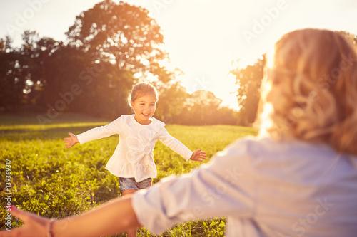 Photo  Girl run to mother's hug