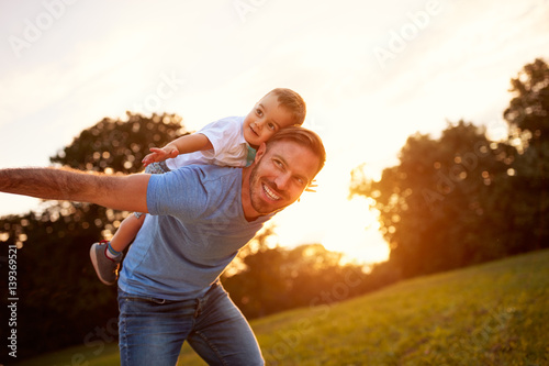 Happy young father with son in park