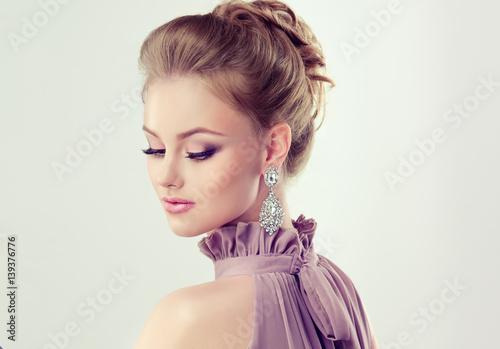 d24f275eeeda3 Beautiful girl with elegant hairstyle and big earrings jewelry ...