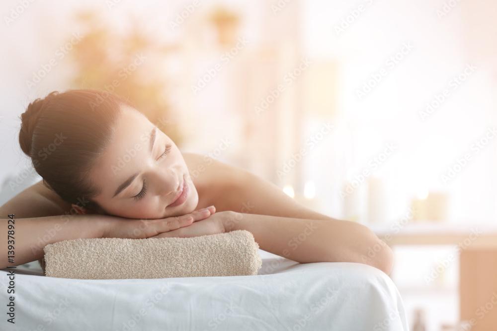 Fototapeta Beautiful young woman in spa salon