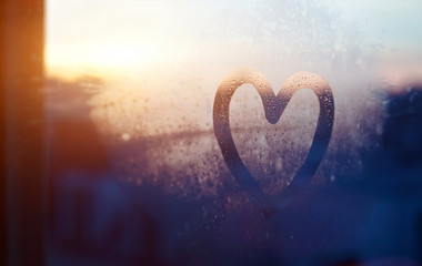 valentines day card, love and kindness concept, heart painted on frozen glass window