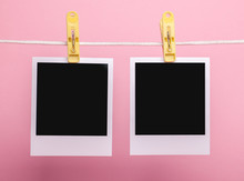 Two Blank Insta Photo Frames On Clothes Pins On Rope Isolated On Pink Background