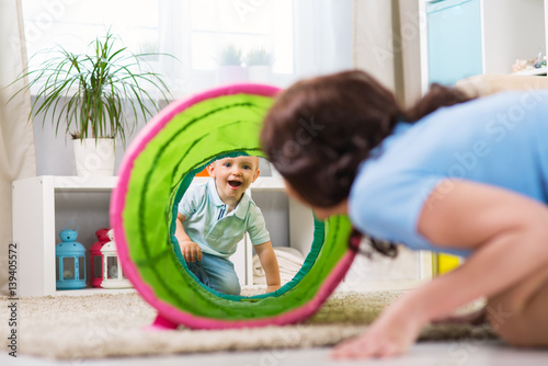 Fototapeta Mother with child playing in the home obraz