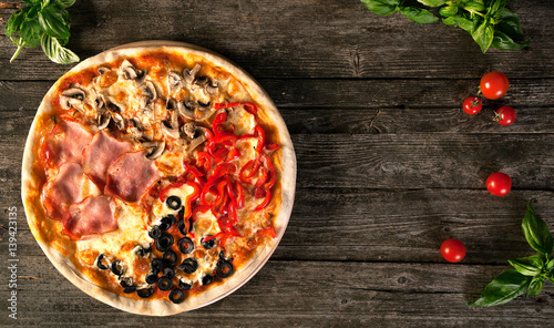 Spoed Foto op Canvas Pizzeria Tasty pizza on a wooden background.