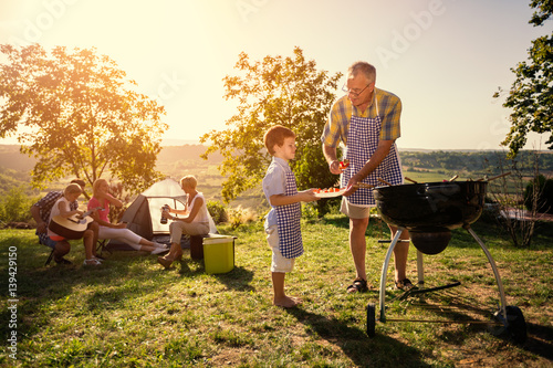 family picnik with barbecue.
