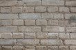 Grey brick wall with cement texture background