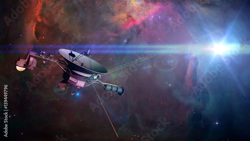 Fotografie, Obraz  Voyager spacecraft in front of a nebula in deep space