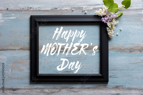 Picture Frame With Lilac Flowers And Happy Mothers Day Message On
