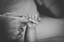 Newborn Baby Touching His Moth...
