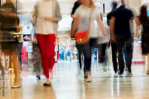 Fotografía  Abstract defocused motion blurred young people walking in the shopping center, urban lifestyle concept