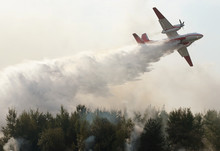 Plane Drops Fire Retardant And...