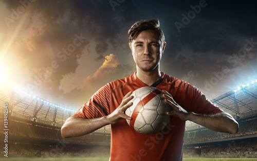 Fotografie, Obraz  soccer player on a soccer playground with a ball