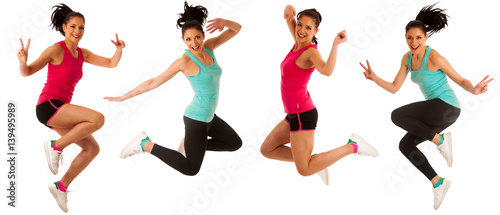 Fototapeta Happy fit and slim woman dancing and jumping isolated over white background obraz