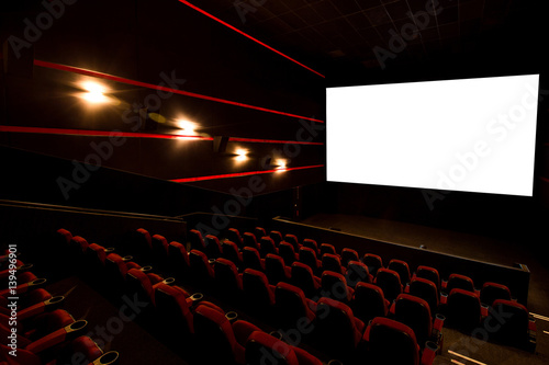 Cinema hall, white screen with copy space and empty armchairs Wallpaper Mural