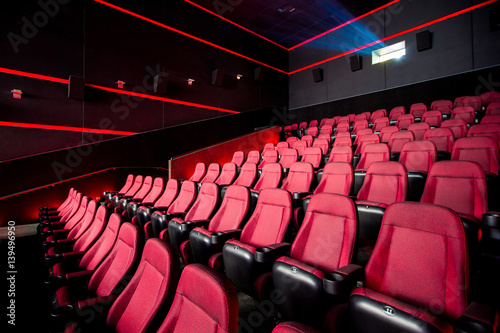 фотография Cinema hall, movie theater, theatre with red armchairs