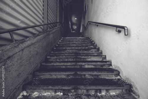 Staande foto Industrial geb. Industrial warehouse concrete staircase, black and white