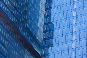 Modern skyscrapers with window reflections of blue sky
