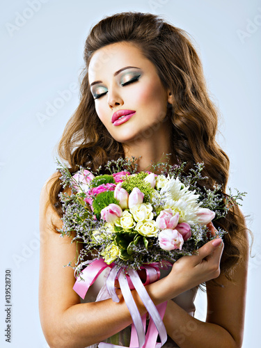 Portrait of beautiful girl with flowers in hands Poster