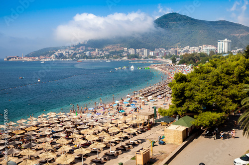 Poster Oceanië Montenegro beaches with a lot of people and sun umbrellas