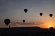 Hot air balloons silhouette over spectacular Cappadocia.