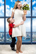 Woman and child with bouquet of flowers. Spring family holiday concept. Women's day.