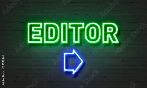 Photo Editor neon sign on brick wall background.