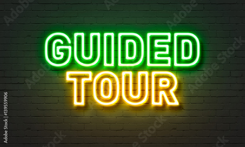Obraz Guided tour neon sign on brick wall background. - fototapety do salonu