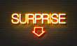 canvas print picture - Surprise neon sign on brick wall background.