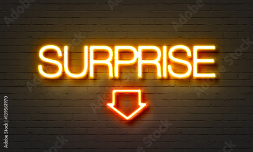 Surprise neon sign on brick wall background. Fototapeta