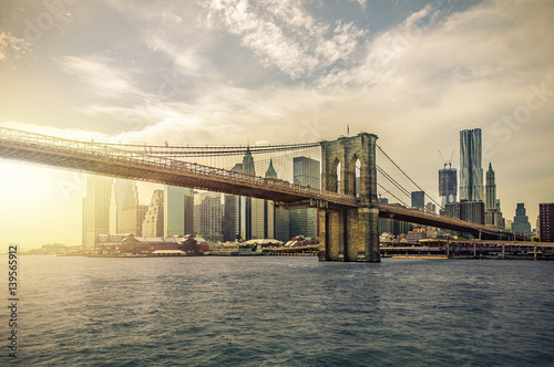 Manhattan Skyline with Brooklyn Bridge, New York City, USA, with lens flare