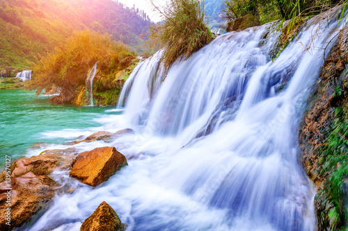 Fototapety, obrazy: Jiulong waterfall in Luoping, China.