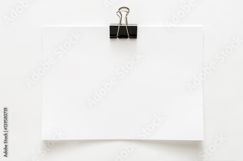 Photo  Blank paper sheet attached with clip isolated on white background