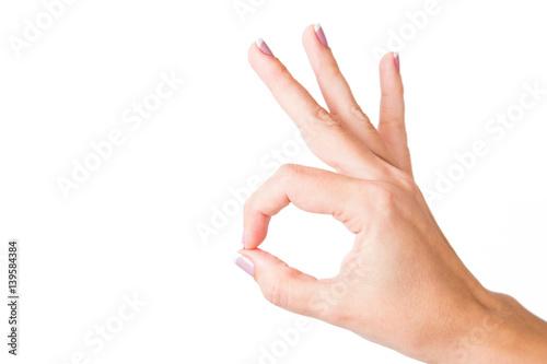 Valokuva  Close up of female caucasian hand isolated on white background